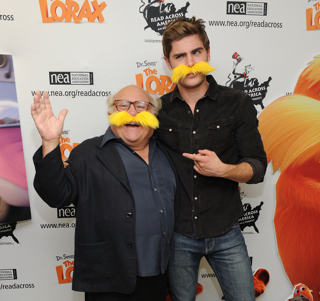 Zac Efron got into character next to Danny DeVito.