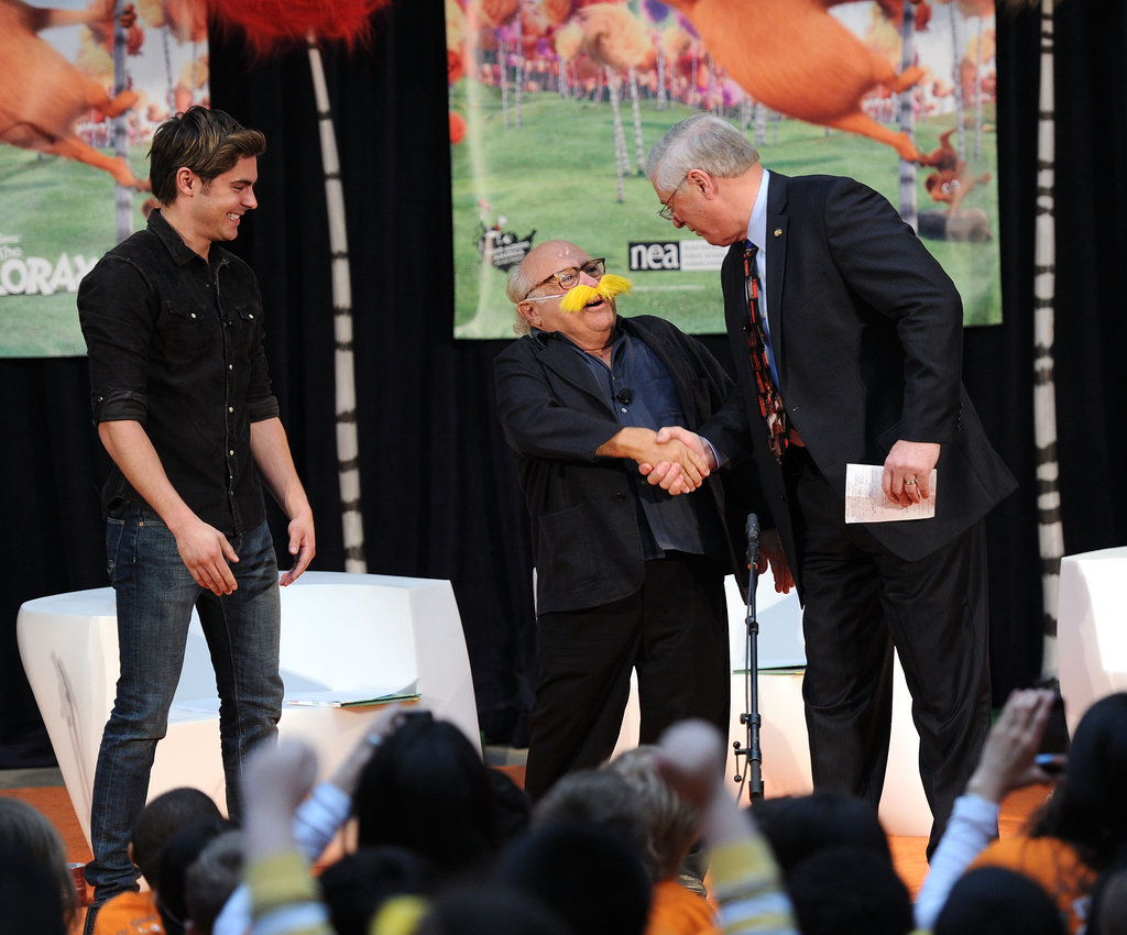 Danny DeVito and Zac Efron read to children at the New York Public Library.