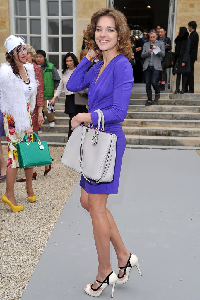Natalia Vodianova smiled pretty for the camera in a vibrant purple dress and chic pumps.
