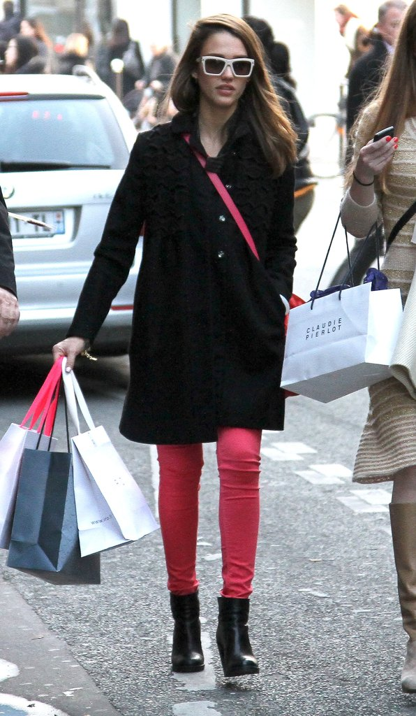 Jessica Alba enjoyed some shopping time while in town for Paris Fashion Week. We love how she's working the brights trend via hot pink jeans paired with black accompaniments.