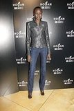 Alek Wek showed off her off-duty style at the Hogan presentation wearing a Hogan leather jacket, denim jeans, and black sandals.