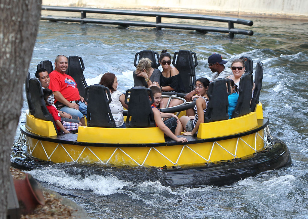 Vanessa Hudgens and Ashley Benson did their best to stay dry on the water rides.
