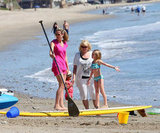 Heidi Klum and Leni Samuel prepped to paddleboard while Lou Samuel held hands with Heidi's mother Erna.