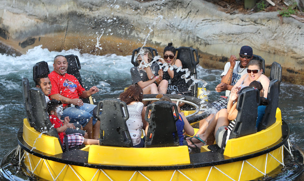 Vanessa Hudgens and Ashley Benson huddled together on the water ride.