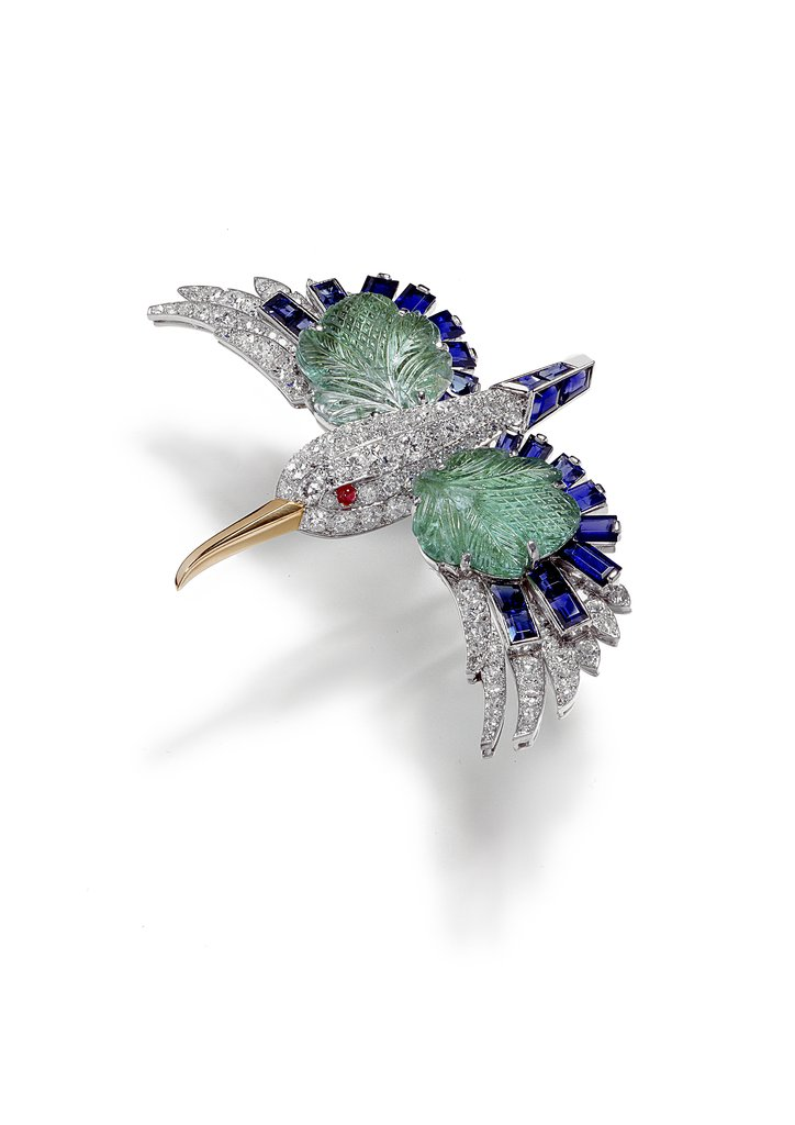 This bird brooch — which, like many of the animal-inspired pieces, comes alive in the film — was made of brilliant and single-cut diamonds, with wings made of leaf-shaped emeralds and faceted sapphires.