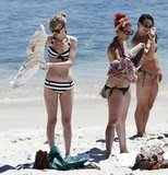 Taylor Swift hung out at the beach in her bikini.