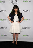 Zooey Deschanel hit the PaleyFest black carpet in a white dress.