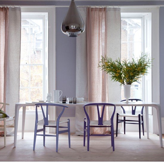 Muted shades of lavender and peach feel incredibly modern when coupled with a silver teardrop pendant and ombre dining chairs.  Source