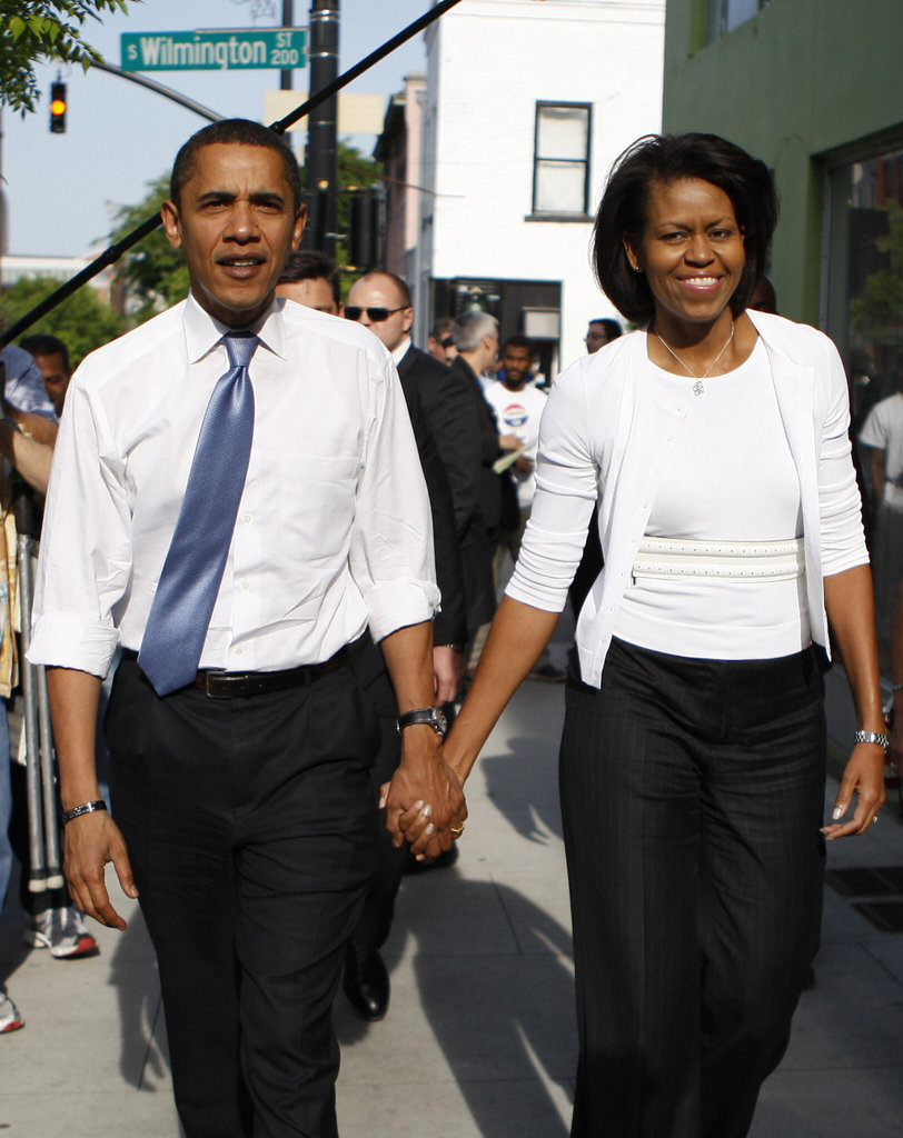 Barack and Michelle walk hand in hand in North Carolina.