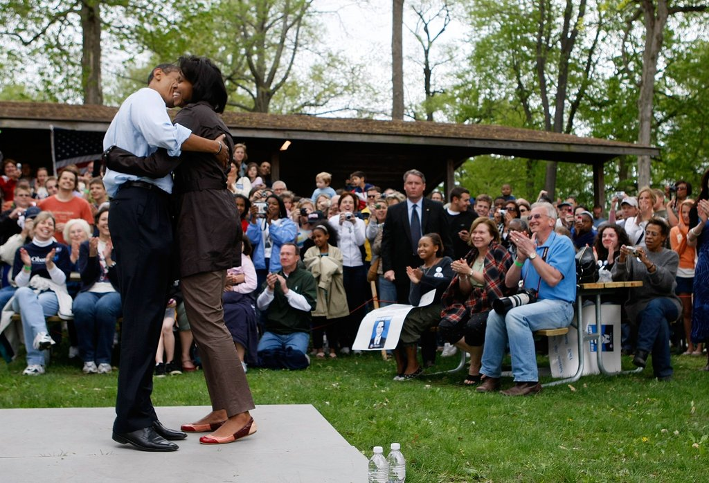 Aw. Barack and Michelle put on a show at a picnic event in May 2008.