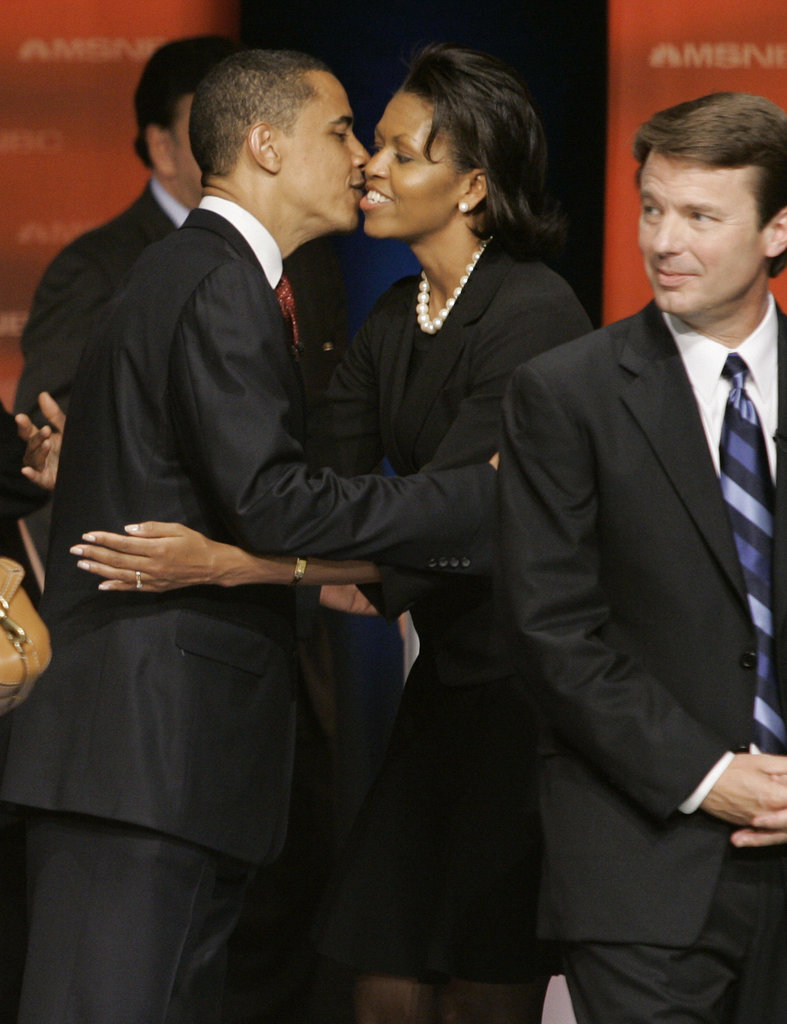 Michelle greeted Barack after the South Carolina Democratic Party Presidential Primary Debate in April 2007.
