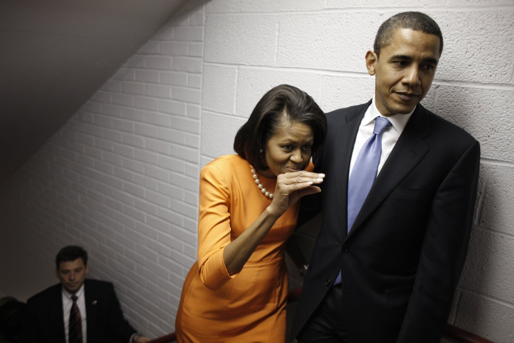 Michelle goofed off while keeping close to Barack.