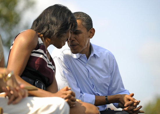 The Obamas put their heads together in Detroit.