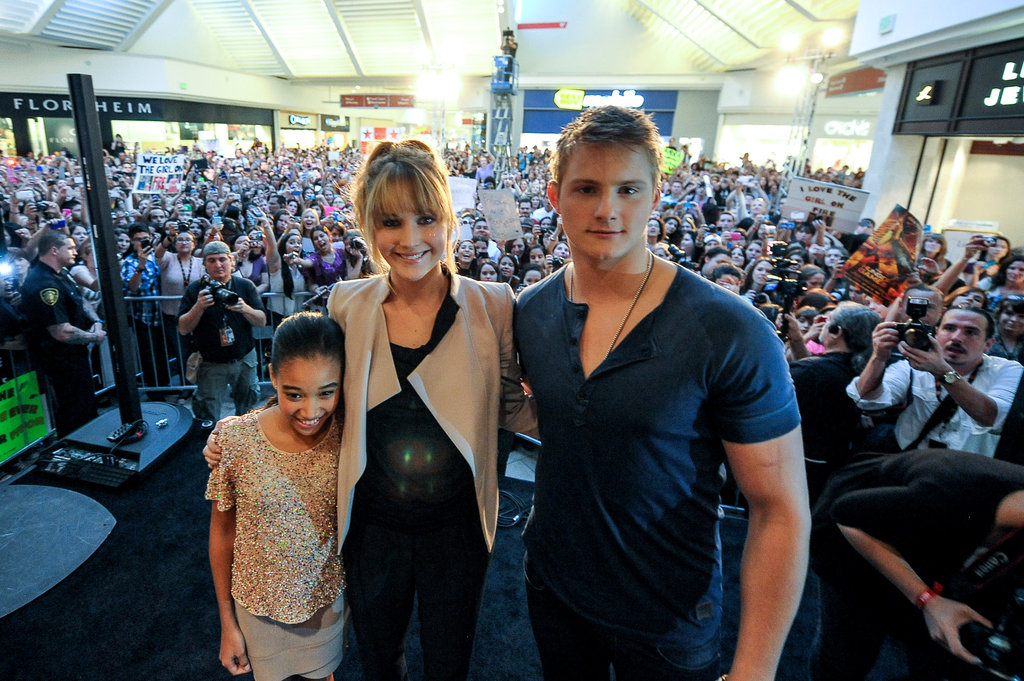 Jennifer Lawrence, Amandla Stenberg, and Alexander Ludwig were met by hundreds of fans at a mall in Miami.
