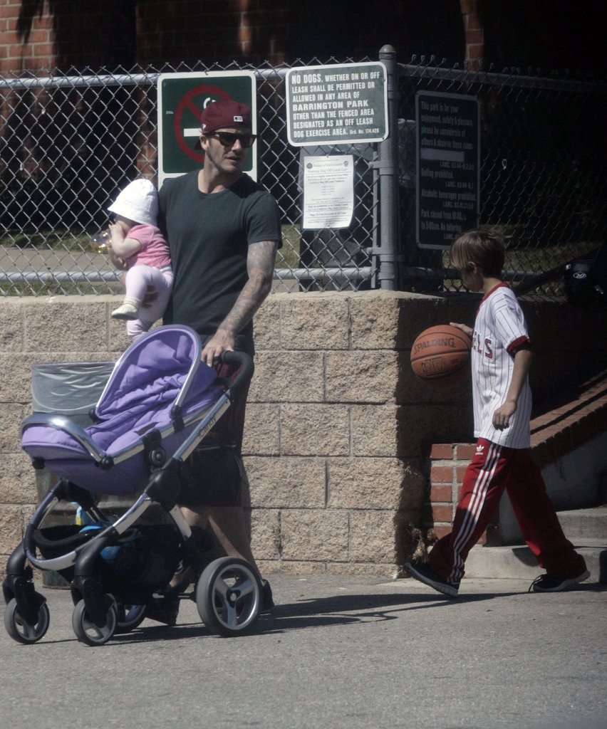 David Beckham kept an eye on his kids, including daughter Harper Beckham.