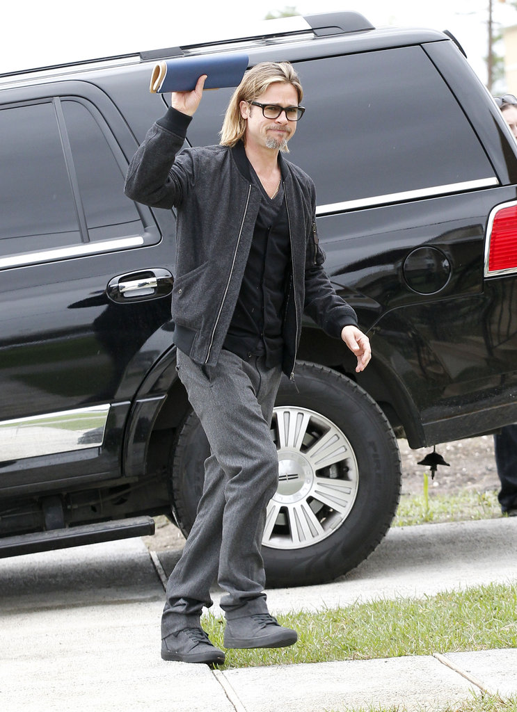 Brad Pitt looked happy to be checking out the newly built homes.