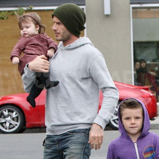 David Beckham held Harper.