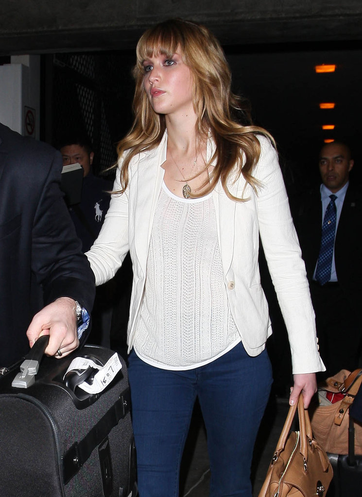 Jennifer Lawrence helped carry her bags.