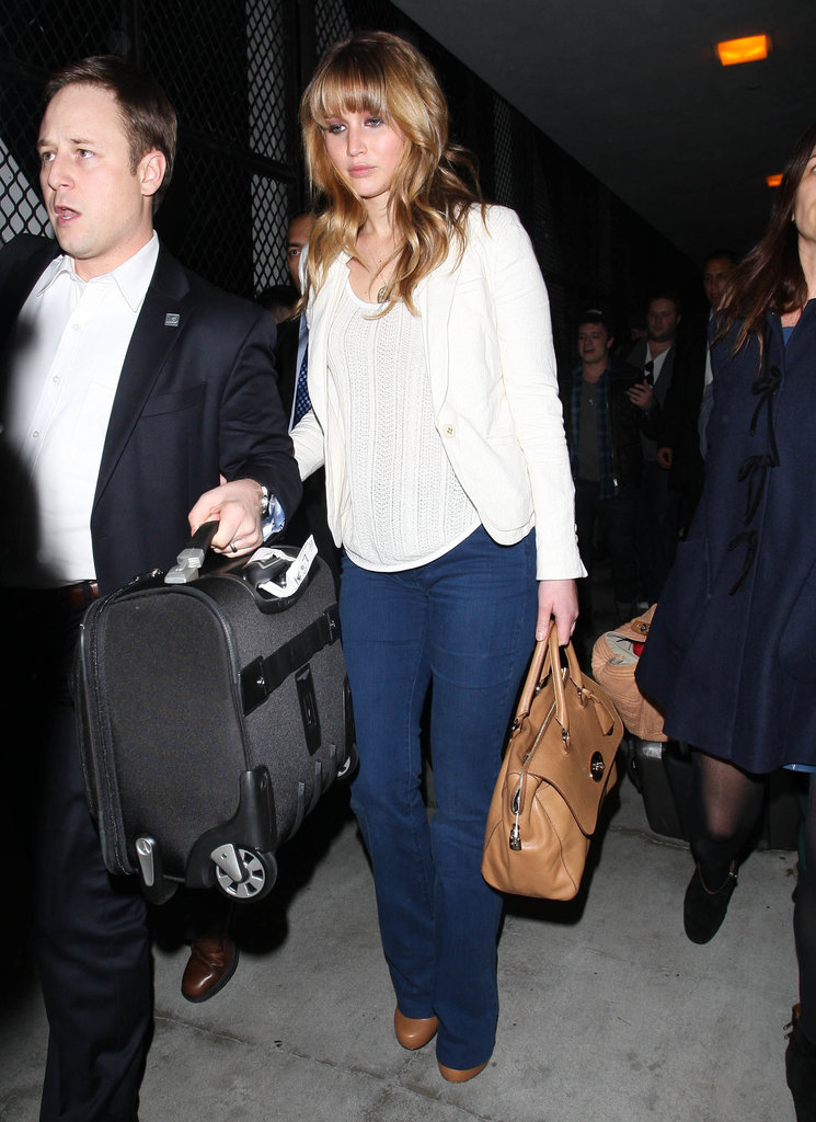 Jennifer Lawrence made an evening arrival in jeans and Alejandro Ingelmo booties.