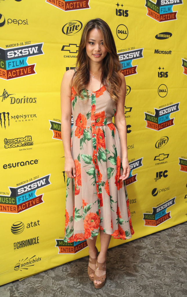 Jamie Chung hit up SXSW to promote her film Eden in a pretty floral maxi dress and beige sandals. For chillier days, layer the look with a utilitarian army green jacket.