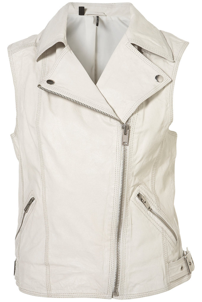 We love the edgy moto silhouette redone in standout seasonal white. Pop this over a colorblocked look for instant cool-girl results.  Topshop Studded Dollar Sleeveless Biker Jacket ($330)