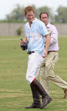 Prince Harry holds a bottle of Royal Salute Whisky after playing polo in Brazil.