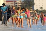 Vanessa Hudgens, Selena Gomez, and Ashley Benson on the beach in bikinis.