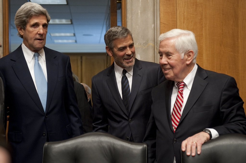Senator John Kerry, George Clooney, and Senator Richard Lugar at a meeting.
