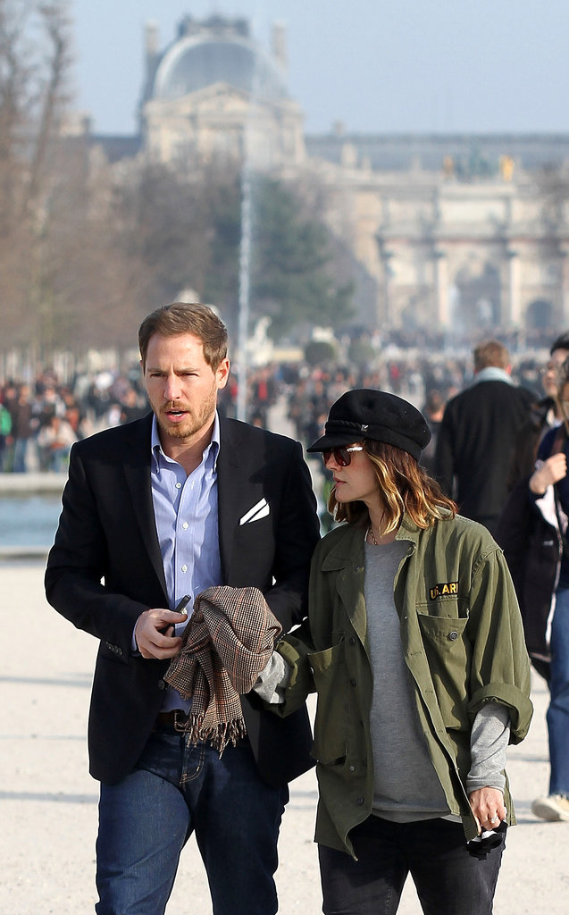 Drew Barrymore holds hands with fiancé Will Kopelman in Paris.