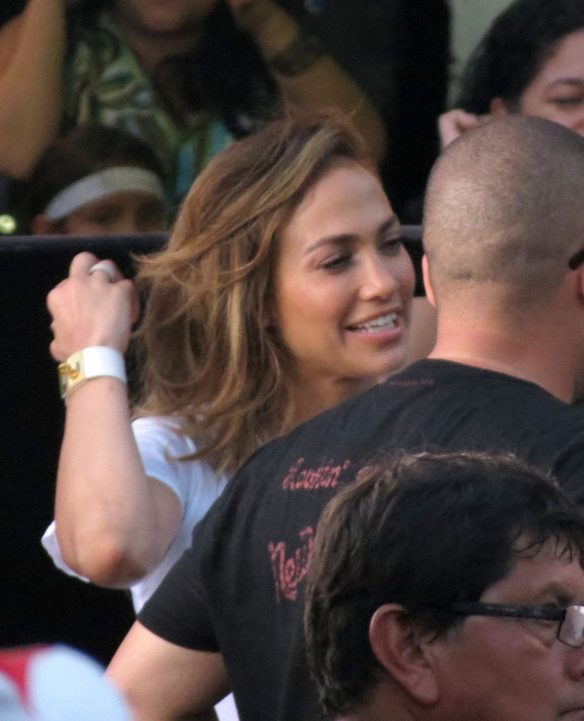 J Lo pushed her hair back.