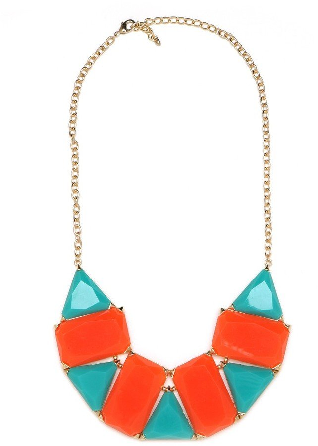 Wear this graphic colorblock collar necklace with a white tee and jeans for a fresh springtime look.  BaubleBar Tribal Mosaic Necklace ($38)