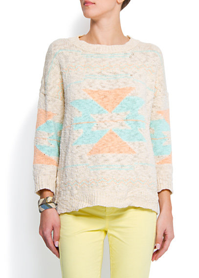 Pair this slouchy sweater with a pair of skinny white jeans and suede ankle boots.  Mango Navajo Style Jumper ($40)
