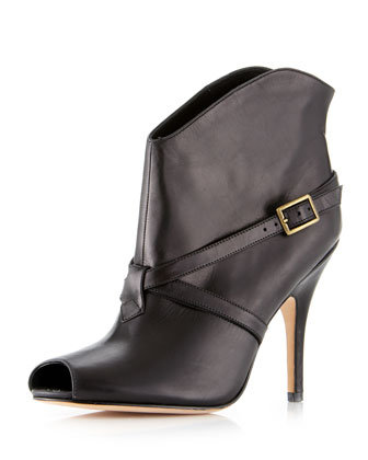 We adore the crisscross buckle detail because it's totally dynamic but not over-the-top chunky. Delman Edie bootie ($135)