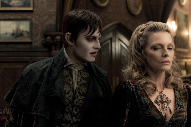 Johnny Depp as Barnabas Collins and Michelle Pfeiffer as Elizabeth Collins Stoddard in Dark Shadows.  Photo courtesy of Warner Bros.