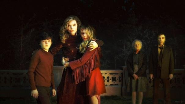 Gulliver McGrath as David Collins, Michelle Pfeiffer as Elizabeth Collins Stoddard, Chloë Grace Moretz as Carolyn Stoddard, and Jonny Lee Miller as Roger Collins in Dark Shadows.  Photo courtesy of Warner Bros.