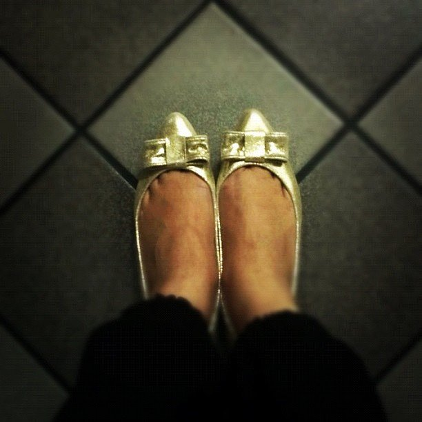 Vitsky got in on the bow-adorned shoe trend with her new metallic kicks.