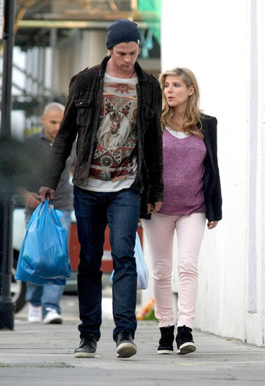 Pregnant Elsa Pataky and Chris Hemsworth in London.
