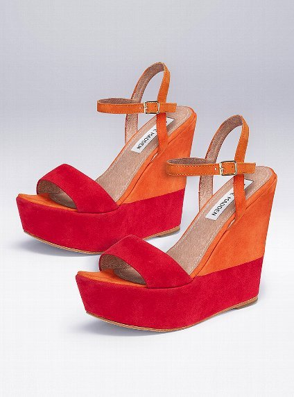 The ultimate party shoe — we adore the bold orange and red colorblocked effect.  Steve Madden Wimzikul Suede Platform ($100)