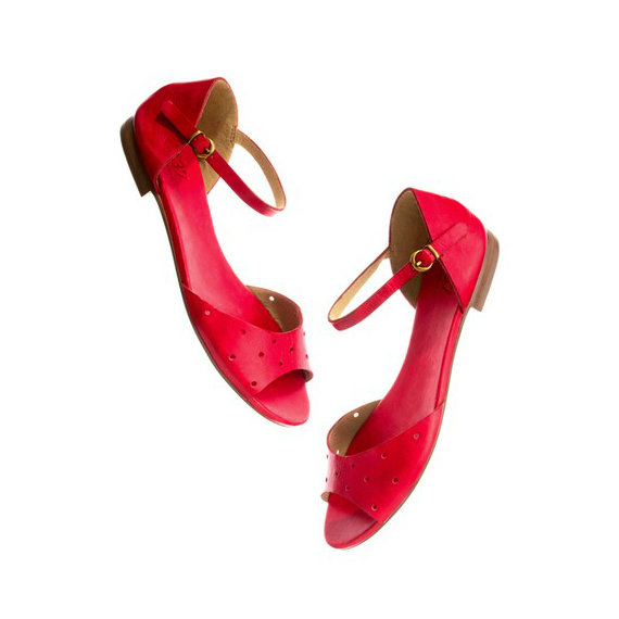 Artsy and vintage-esque, these Holepunch flat sandals are an edgier, adult version of something you might have worn as a kid. Madewell the Holepunch Flat Sandal in Siberian Red ($80)