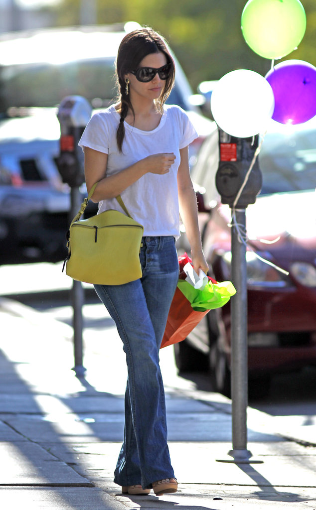 Rachel Bilson kept it simple in easy flares and a white tee — with just a pop of colour on her bag.