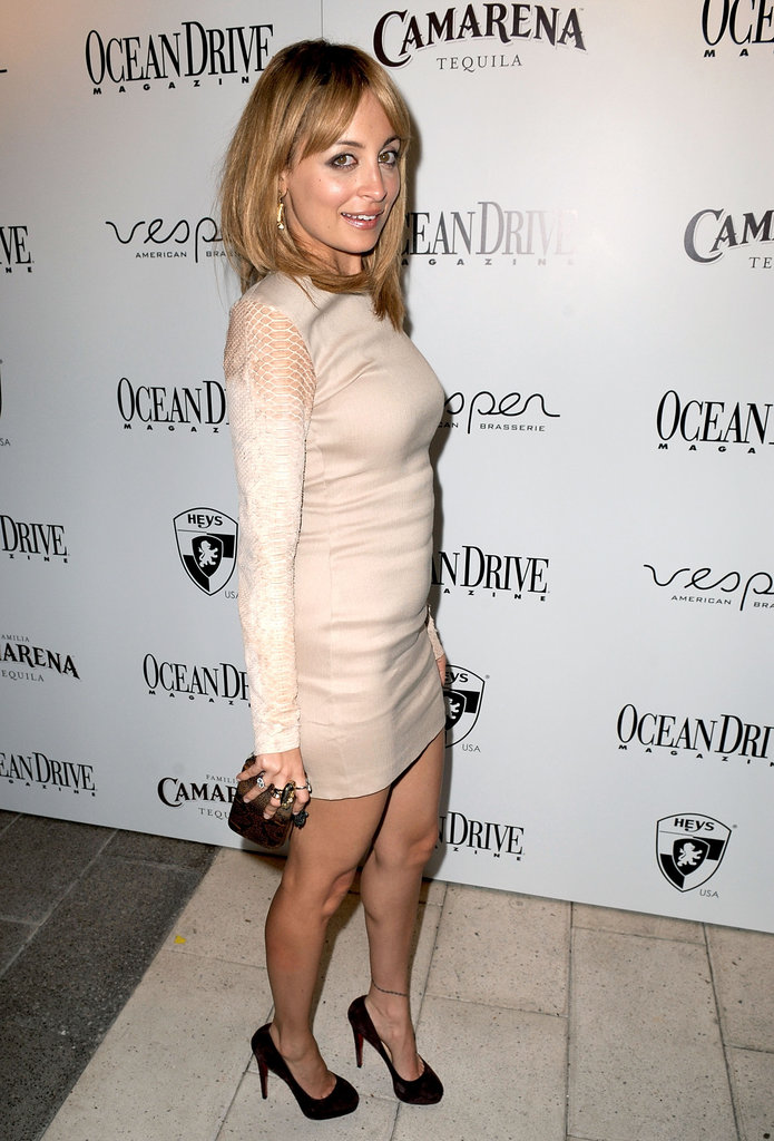 Nicole Richie carried a small clutch.