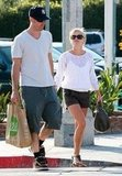 Jim Toth helped Reese Witherspoon with the groceries after a Summer 2010 trip to an LA Whole Foods.