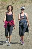 Reese Witherspoon goes on a hike with a friend in LA amidst pregnancy rumors.