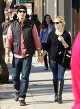 Jim Toth and Reese Witherspoon held hands in Dec. 2011.