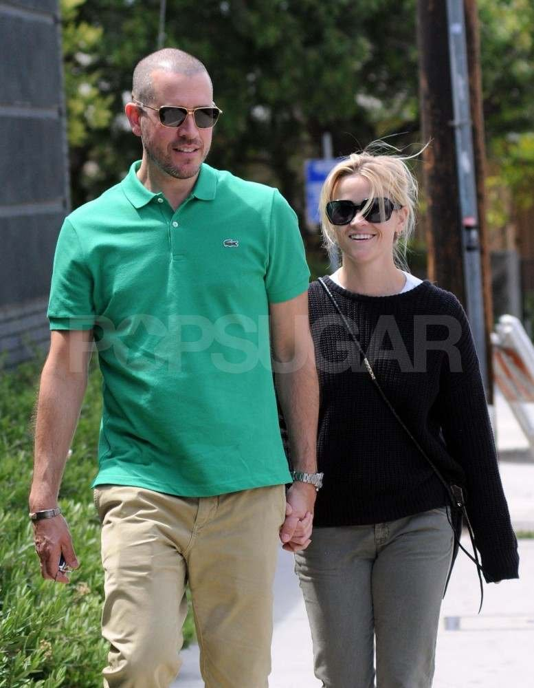 Jim Toth and Reese Witherspoon held hands while out in LA in June 2011.