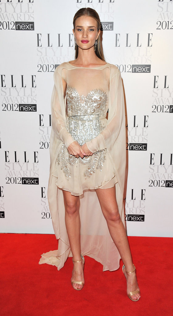 Rosie Huntington-Whiteley went for an ethereal look with her sheer cape effect.