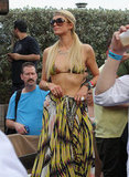 Paris Hilton was well accessorized while hanging out poolside in Miami.
