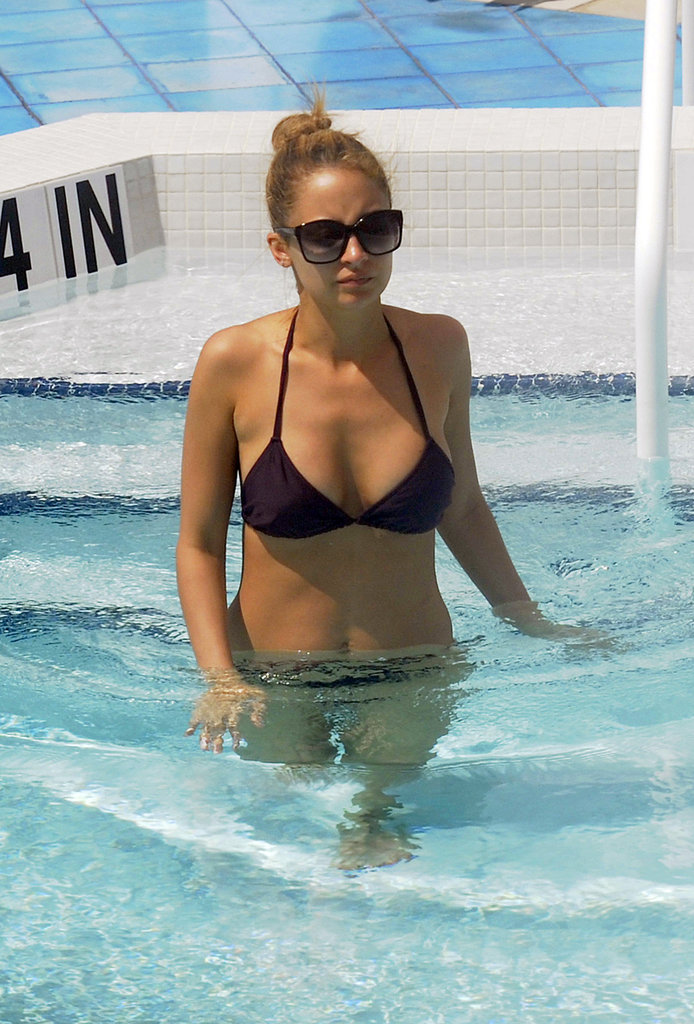 Nicole Richie takes a dip in the pool while relaxing at her hotel in Miami Beach.
