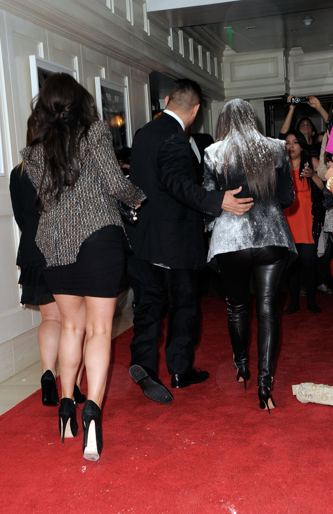 Kim Kardashian covered in flour at the True Reflection fragrance launch.