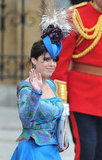 Princess Eugenie waves to crowds at her cousin Prince William's wedding.